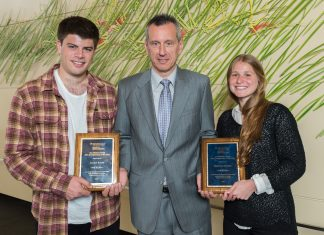 Ross students Daniel Freed (BBA '15) and Kathryn Roiner (BBA '16) are presented with the 2015 Weiser Family BBA Entrepreneur of the Year award. Freed and Roiner are the the co-founders of Companion, which was the top winner of the 2015 Michigan Business Challenge. Companion is a peer-to-peer safety network that allows people to stay safe by keeping in touch with others while walking from one place to another.